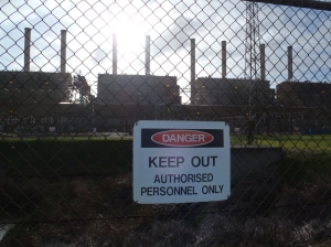 Danger Keep out - power station polluting