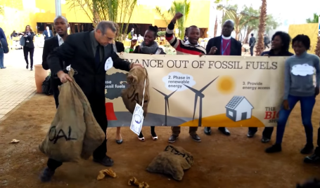 Protest at COP22 on coal and poverty via DesmogBlogUK